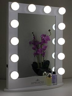Hollywood Classic XL Vanity Mirror By Impressions Vanity (White) Impressions Vanity http://www.amazon.com/dp/B00WHF5IQW/ref=cm_sw_r_pi_dp_r6rsvb0MPZMNC