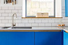 Corian concrete worktop, white tiles and under mounted double sink unit https://www.bathbespoke.co.uk/kitchens/