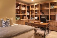 This desk faces out which is perfect Feng Shui.  I would put the computer on my desk so my back was never to the room.   Traditional Home Office with Carpet, High ceiling, Built-in bookshelf, Custom Made Oak Wall Unit