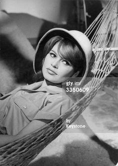 Brigitte Bardot wears a topee as she reclines in a hammock in a scene from the film 'La Bride sur Lecou' Brigitte Bardot Young, Bridget Bardot, Anita Ekberg, Julie Christie, Lauren Bacall, Jane Fonda, Charlie Chaplin, Sophia Loren, Divas