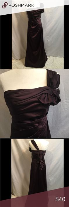 Breathtaking David's Bridal Dress. Offers welcome Beautiful David's Bridal Chocolate dress. Light tule OMG bottom to form straight out look. NWOT. Sz 4. Smoke free home. Please feel free to ask any questions. Thank you for shopping my closet. 🌺🌺 offers always welcome🌺🌺 David's Bridal Dresses