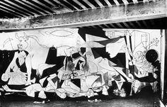 """Art from Spain - Pablo Ruiz y Picasso, (Málaga, 1881- Mougins, 1973), was a Spanish painter. Picasso / War and pain / """"The Guernica"""". La tela era tan grande (3,5 por 7,8 metros) que la mejor solución fue apoyarla, levemente inclinada, enuna de las paredes del ático del estudio, en una casa que había encontrado Dora Maar en la Rue des Grands-Augustin, una casa que perteneció al escritor Honoré de Balzac. Imagen del 'Guernica' tomada por Dora Maar en una fase avanzada."""