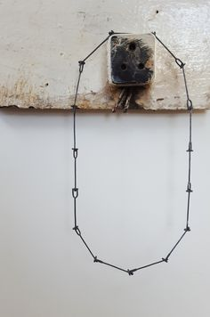 Created from welded forms, this chain articulates with a ball and open socket and displays the textures of its making.