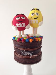 M&M figurines on naked cake