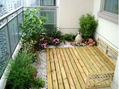 wood and gravel balcony garden