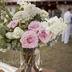 Pink Rose Centerpieces    Jars filled with garden roses, wildflowers, and peonies kept the centerpieces sweet and simple.
