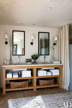 The master bath's mirrors, sconces, and vanity were custom made | archdigest.com