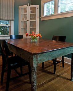 Love the table, the wall color, & having the china/dinnerware cabinet in the corner