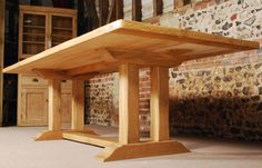 "'The Pillars' English Oak Trestle Table is one of our larger tables at approximately 9 feet in length. The Oak Trestle Table has a solid oak top 2.5"" thick."