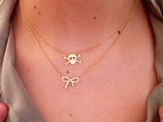 Layer it, skull necklace and bow necklace. Available at www.roaraccessories.com.au