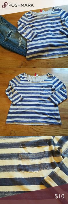 Divided 3/4 sleeve shirt size size 2 A blue and white stripped 3/4 sleeve shirt by divided. Size 2. Has a pocket in the front. Barely worn no damage or worn spots. Super cute shirt.  Make me an offer Divided Tops Tees - Short Sleeve