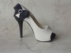 Check out this item in my Etsy shop https://www.etsy.com/listing/236977299/black-and-white-platform-peep-toe-high