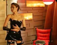 Angelina Jolie wore a costume latex dress, making her the ultimate femme fatale, as if that wasn't already established before. The dominatrix-inspired ensemble, complete with fishnet tights, was whimsically softened by pastel pink bows. Jolie fell in love with Brad Pitt on the set—and yes, that's how one of the greatest romances of all time began. We'd like to think this outfit had something to do with it.   - ELLE.com