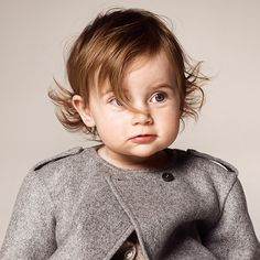 Keeping warm in a super soft cashmere shell jacket from the Burberry Autumn/Winter 2014 childrenswear collection