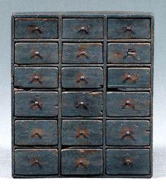 Blue painted 18-drawer apothecary,  poplar and pine throughout with old blue paint, nailed construction, American, 19th century, 30 x 26 x 8 in.    Strip patch at back of top, backboards replaced, cracks, separations, wear, and minor losses throughout.