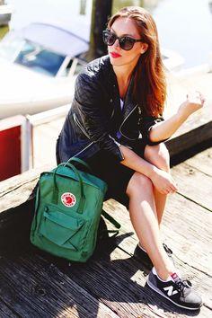 Fjallraven Kanken backpack + New Balance sneakers.