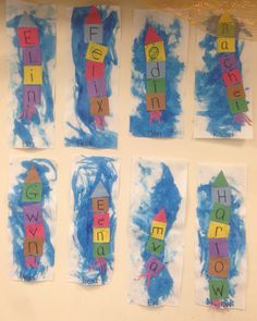 Name rocket ships. Toddler children painted a blue background and glued on the letters in their name to create a rocket ship.