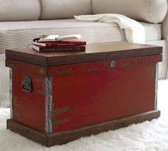 Josefa Distressed Trunk | Pottery Barn--love the color and check out the pulls....