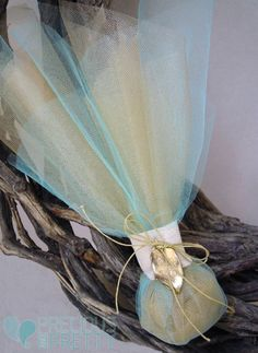 Greek wedding favors with aqua and gold tulles