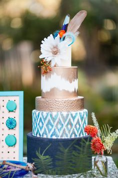 Stunning details on this Ikat Wedding Cake! Gold, Turquoise, Navy & Orange.   Bohemian Desert Wedding with Mid-Century Influence