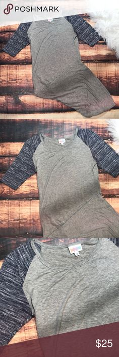 "LuLaRoe Julia Grey Heather Blue Baseball Dress Super cute casual dress! Looks like a feminine baseball jersey, or a raglan tee dress! Very cute paired with your chucks! Tag say ""product may contain any or all of the following materials Rayon, Polyester, Lycra, cotton, nylon MADE IN USA"". Stretchy! Laying flat bust measures Approximately 17 inches unstretched and approximately 41 inches in length. Gently used condition. No flaws. Slight pilling but it is unnoticeable LuLaRoe Dresses"