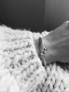 Big knit & knot bracelet. Via Mija