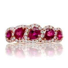 This ruby ring is accented by diamonds to bring out the beautiful vibrant red color. Also keep an eye out for the sapphire version also available. DETAILS ON RING LISTED Metal: 18 karat rose gold, 2.81 grams Diamond: 52 Round brilliant cut diamonds, 0.41 carats, VS1-VS2 clarity, F-G