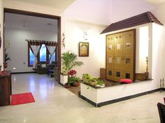 Slope roof and low height wall designed in the puja room gives a traditional look in this courtyard. Temple Design For Home, Indian Home Design, Indian Home Interior, Indian Home Decor, Home Interior Design, Room Interior, Pooja Room Door Design, Dining Room Design, Dining Rooms
