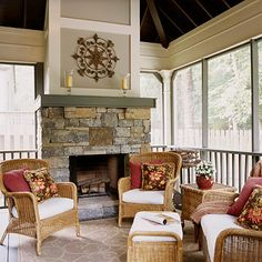 This porch is perfect for year-round enjoyment! We love the wood-burning stone fireplace.