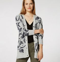 This covetably cozy cardigan bursts into bloom with beautifully brushed florals…