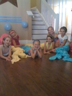 Mermaid Party- tails made out of beach towels. TOO CUTE!!