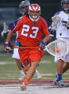 Brett Queener #23 of the Hamilton Nationals runs with the ball during Major League Lacrosse game action against the Charlotte Hounds on August 4, 2012 at Ron Joyce Stadium in Hamilton, Ontario, Canada.