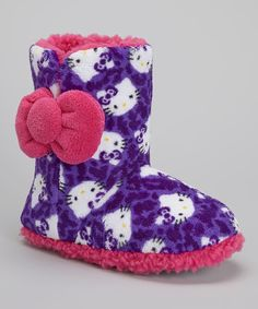 b3a730bc2 Hello Kitty meets hello comfort in these oh-so cozy slippers. A fun leopard  print and big bow adorn the boot, keeping cuddling up fun and toasty-warm.