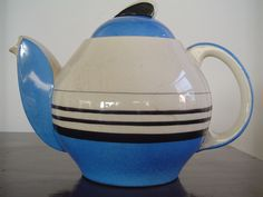 """an art deco teapot made in Kyoto, Japan with banded decoration. In the bottom has a red stamped mark: """"IDEAL IRON STONE CHINA SK KYOTO TOKICO.""""  Date c. 1925, Taisho period"""