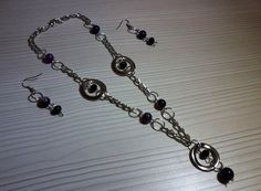 Juego de collar y aretes en níquel, ágatas y cristales