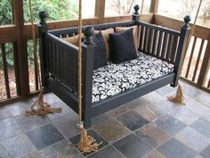 Refurbished crib into a porch swing!