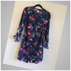 MERONA FLORAL  SHIRT DRESS Very cute like new... Floral shirt dress in small/medium.. Tag says Small Petite but it fits up to Medium Merona Dresses