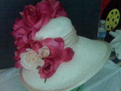 The hat speaks of spring time! the joy of color and style.