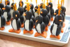 "Recipe: Olive Penguins - These are such a fun holiday appetizer! Kids and adults both love them. The filling can be cream cheese, soft goat cheese, or even a cashew based ""cheez""."