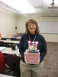 """Patty Cox with her prize from the Library Lunch and Learn """"Words and Pictures: Translating Literature into Film"""" raffle!"""