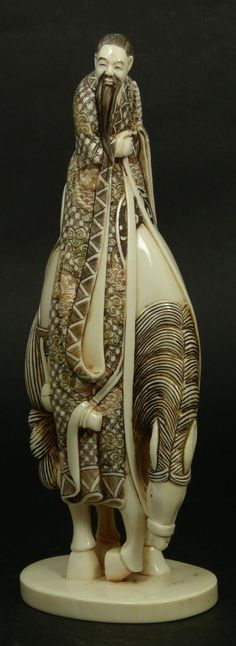 beautifully carved and polychromed Japanese ivory sculpture depicting a wiseman on horseback.