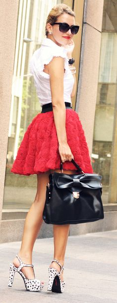 I love it, even with the belt. Love the rose textured skirt & black & white polka dotted shoes. Life is rosy