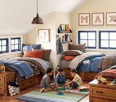 boys bedroom idea...the king pillows on a twin bed - very cozy.  I like the name art above the window too.