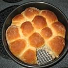 Hawaiian Bread!!!!        2 (.25 ounce) envelopes active dry yeast      1/2 cup warm water (110 degrees F/45 degrees C)      3 eggs      1 cup pineapple juice      1/2 cup water      3/4 cup white sugar      1/2 teaspoon ground ginger      1 teaspoon vanilla extract      1/2 cup butter, melted      6 cups all-purpose flour