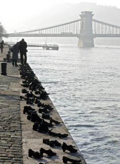 Iron shoes are pictured on the bank of the Danube on January 27, 2012, marking the Holocaust in Hungary. Hundreds of Hungarian Jews had to leave their shoes on the bank before they were shot into the...