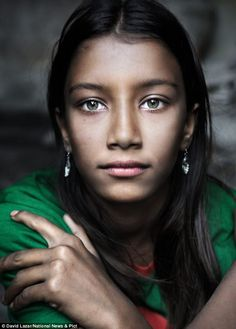Someone should introduce her to Tyra...  Beauty: The girl with the green eyes was spotted playing in a Bangladeshi village by a travel photographer