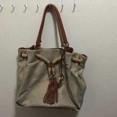 Authentic gold MK purse Used a lot but still a lot of use remains. On of the straps was broken but it is fixed now. The price reflects the condition Michael Kors Bags