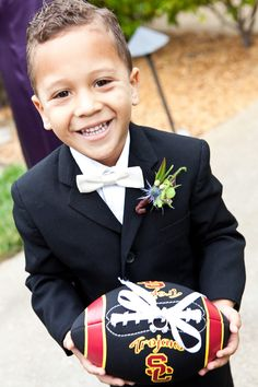 love this idea for a ring bearer!! :) football   Definitely something that would fit our boys!