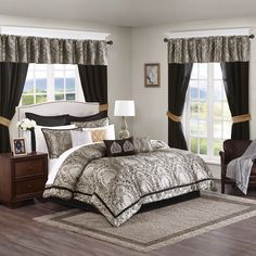 Update your entire room at one time with the Madison Park Essentials Christine 24 Piece Room in a Bag. This traditional pattern creates an opulent look in your space with its ornate damask design in rich gold, silver, and black tones.