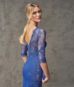 FERNANDA- Georgette and lace flared dress. Georgette bodice with lace appliqués and elbow-length sleeves. Overlay with bateau neckline and sheer sweetheart neckline. Sheer effect on the sides of the bodice.